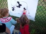 Chloe and Emma try their hand at Pin the Spots on the Cow. :).
