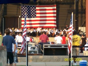 The flag was gorgeous behind the orchestra!