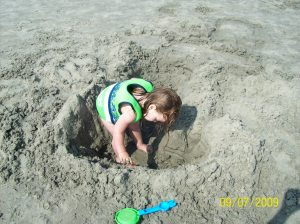 Chloe was determined that she was a pirate and that there was a treasure somewhere in that hole!